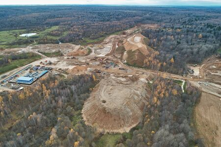 Aerial view with a drone. Landscape with autumn forest and sand quarry.