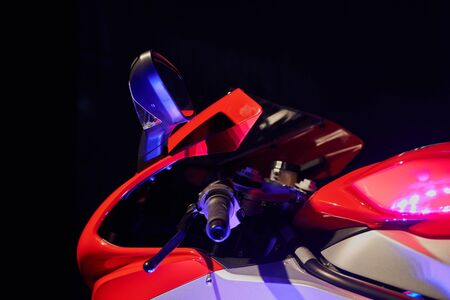 Sportbike on a black background. Front part. Mixed lighting.