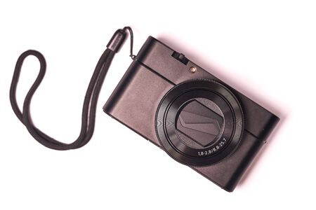 Modern compact digital camera isolated on white background.