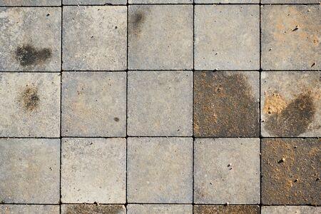 Dalles de pavage en brique carrée. Texture des blocs de béton.