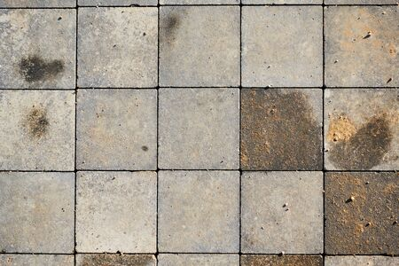 Paving slabs of square brick. Texture of concrete blocks. 版權商用圖片