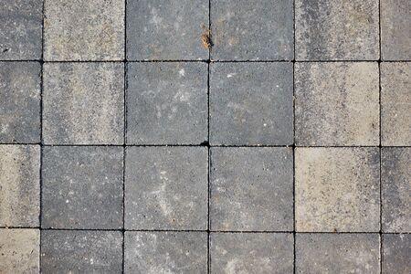 Paving slabs of square brick. Texture of concrete blocks. Stockfoto