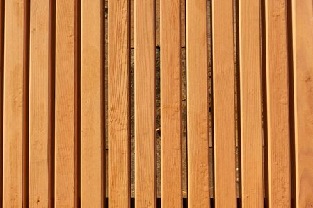 Texture of new wooden slats. Wooden background.