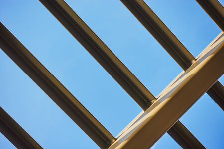 The frame is a metal canopy. Architectural element against the sky. Standard-Bild