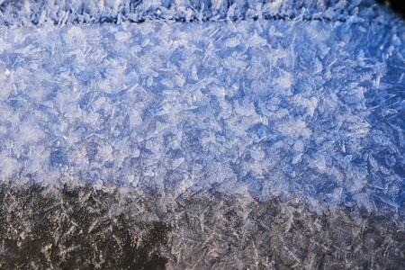 Frosty pattern on the surface in winter season.