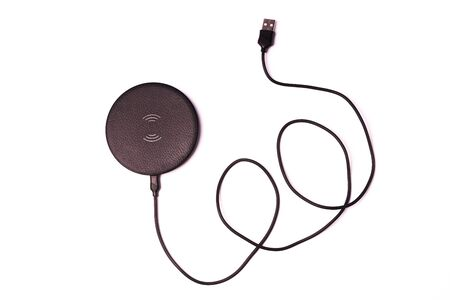 Wireless phone charger isolated on white