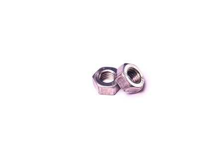 Hexagonal metal nuts isolated on white background.