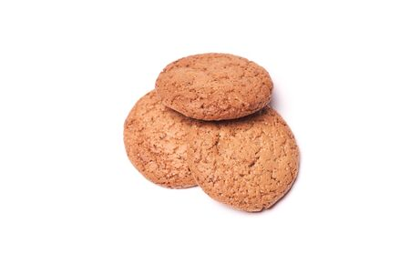 Three homemade oatmeal cookies isolated on white background. Zdjęcie Seryjne