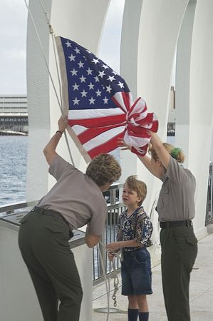 Boy talking to Uss Arizona Memorial staff after military funeral ceremony. Picture taken December 7 2001