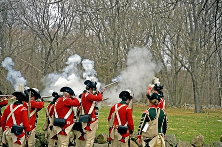 revolutionary war: Concord, USA - April 16, 2011: British soldiers fight the Minute Man on Battle Road in Concord, MA during the Commemorating the Patriot Day. Editorial