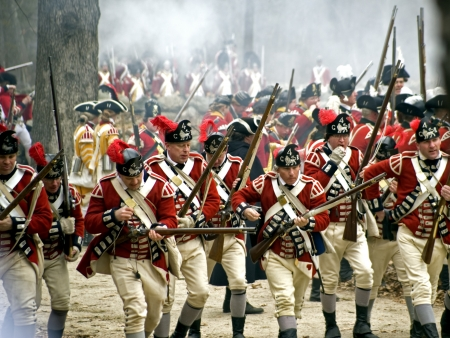 Concord, USA - April 16, 2011: British soldiers fight the Minute Man on Battle Road in Concord, MA