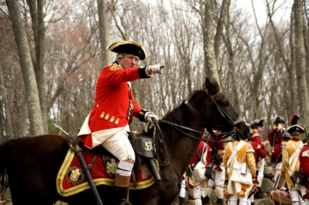 Concord, USA - April 16, 2011: British soldiers fight the Minute Man on Battle Road in Concord, MA during the Commemorating the Patriot Day