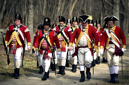 Concord, USA - April 16, 2011: British soldiers on Battle Road in Concord, MA during the Commemorating the Patriot Day