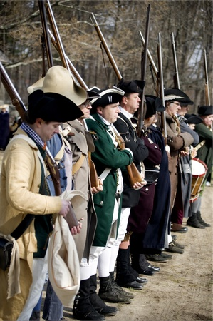 american revolution: USA, Concord, MA - April 16, 2011: Minute Men are getting prepared to fight the British troops on Battle Road in Concord, MA during the celebration of Patriot Day.
