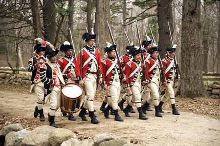 Concord, USA - April 16, 2011: British soldiers march on Battle Road in Concord, MA during the Commemorating the Patriot Day.