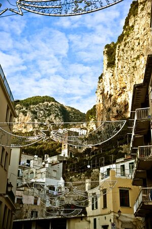View of Amalfi street with Christmas decorations. Stock Photo