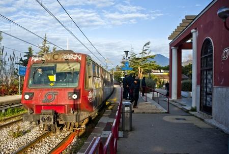 Italy, Pompeii - January 2, 2010: Commuter train Circumvesuviana arrives at the Pompeii Scavi station.