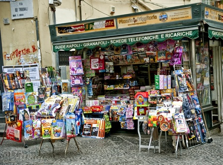 kiosk: Naples, Italy - January 3, 2010: Italian newsstand on Via Tribunale, in the historic part of Napoli sells magazines, maps and periodicals Editorial