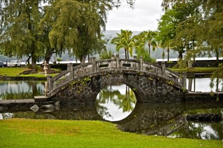 Stone bridge in the Japanese Garden  Hilo, Hawaii