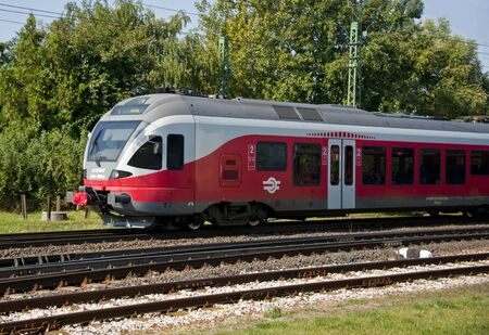Gyor, Hungary - September 26, 2011: Commuter train approaches the train station.