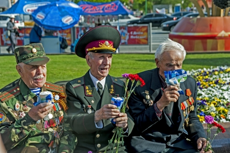 gorky: Moscow, Russia - May 7, 2010: three Soviet World War II veterans eating ice cream in Gorky Park during the Victory Day celebration