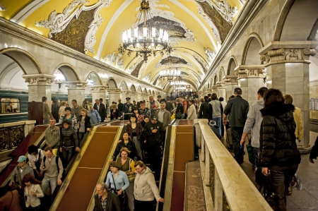 Moscow, Russia - May 8, 2010: people are riding the escalator in a metro station Editorial