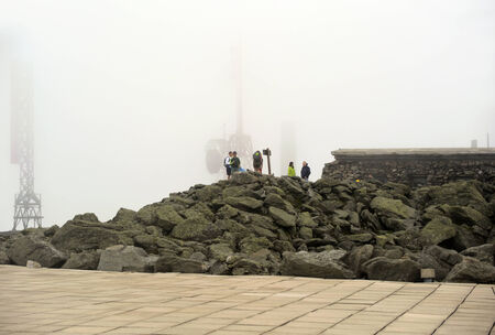 appalachian trail sign: Hikers take photos at the Mount Washington summit, Editorial