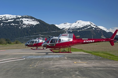 Juneau, USA - May 20, 2013: Helicopters are getting ready to take off to the Mendenhall Glacier