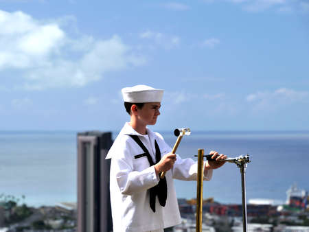 joins: oung man joins naval band playing in Punch Bowl Cemetery
