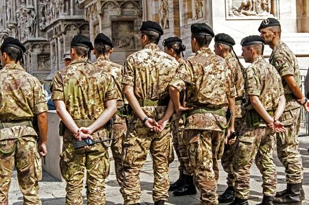 special forces: Special forces standing at the Milan Cathedral Duomo di Milanoof Milan, Italy.