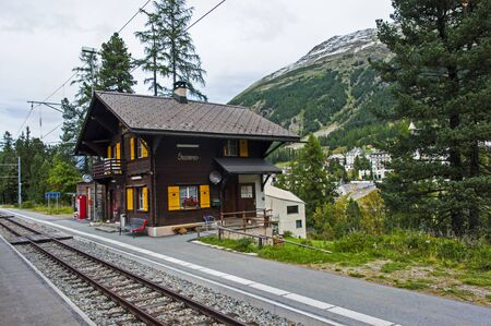 swiss culture: Old train station building in the Swiss mountains near Bernina Pass.