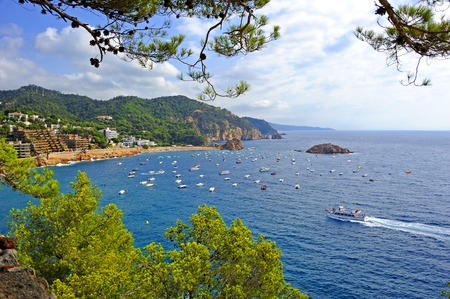 View of the Tossa de Mar bay from the medieval walled town Vila Vella. Stock Photo