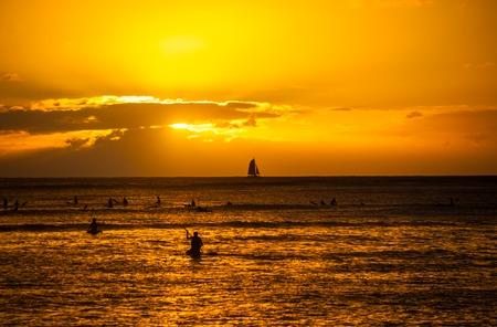 Sunset at Waikiki beach in Honolulu, Hawaii