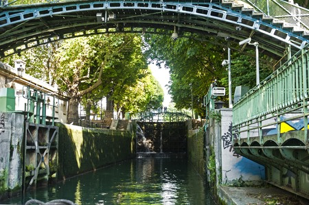 Locks of the Saint-Martin canal in Paris, France Stock Photo