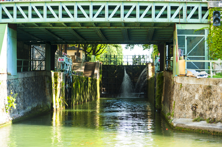 Locks of the Saint-Martin canal in Paris, France Editorial