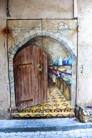 old painted door in Antibes,a Mediterranean resort in the southeastern France, between Cannes and Nice.