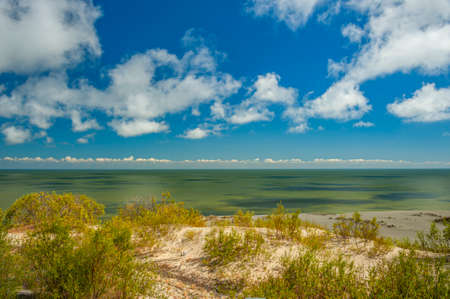 Sand dunes in the Curonian Spit,a narrow peninsula separating the Baltic Sea from the Curonian Lagoon. The northern part of the peninsula belongs to Lithuania, while the southern part is in Kaliningra