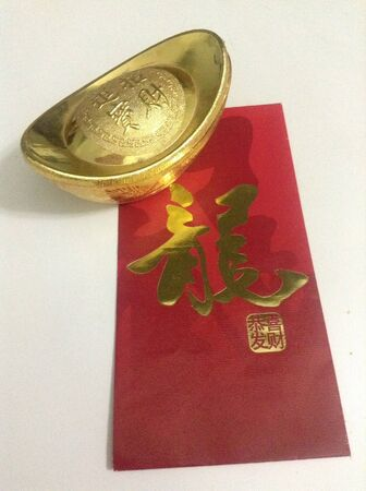 gold: Gold ingot and red packet for Chinese New Year