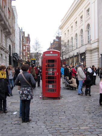 covent: Red phone booth in the middle of busy James Street, Covent Garden, London Stock Photo