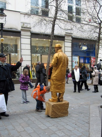 covent: Street performer performing in James Street, Covent Garden, London