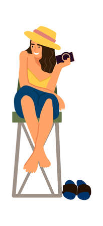 Woman photographer. Cartoon female holding camera. Young character sitting at high chair. Happy barefoot girl taking pictures with photographic devices. Vector traveler shooting photo Stock Illustratie