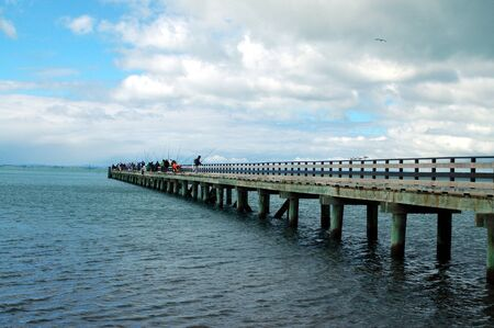 Weekend fishermen gather on Cornwallis wharf photo