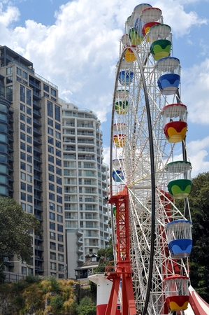 turnabout: Colorful Russian wheel among appartment buildings in Darling Harbour, Sydney, Australia Editorial