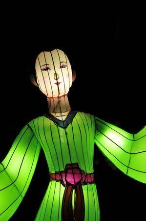 Chinese lantern festival figure dressed in green