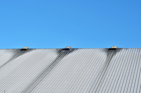 Metal roof dirty around ventilation ducts Stock Photo