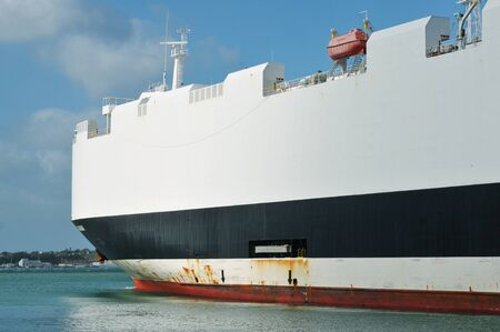 Large cargo ship in seaport photo