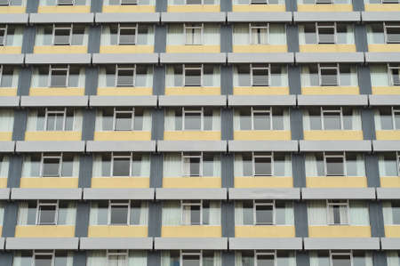 Windows pattern on a tall city building. Stock Photo