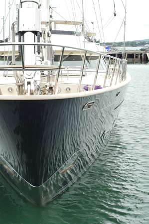 hull: Water reflections on a shiny black hull of a luxurious yacht. Stock Photo