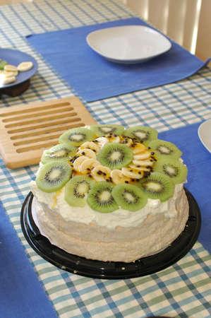 Popular Pavlova cake with kiwifruit and passionfruit.
