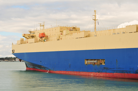 hull: Cargo ship with rust marks on hull